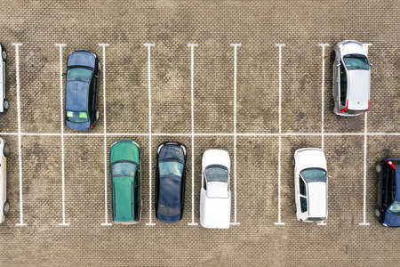 Top down aerial view of many cars on a parking lot of supermarket or on sale car dealer market. Stockfoto