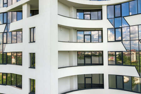 Many windows on new apartment building facade. Stockfoto