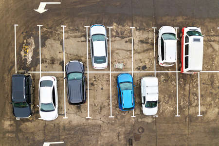 Top down aerial view of many cars on a parking lot of supermarket or on sale car dealer market. Reklamní fotografie