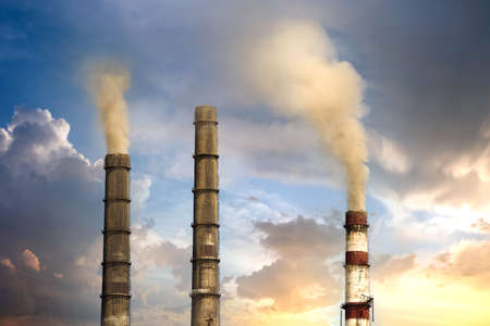 Thermal power station tall pipes with thick smoke. Pollution of environment concept.