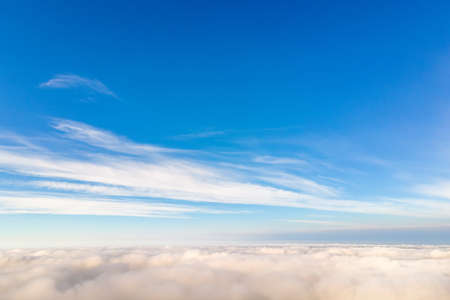 Aerial view from above of white puffy clouds in bright sunny day. Reklamní fotografie