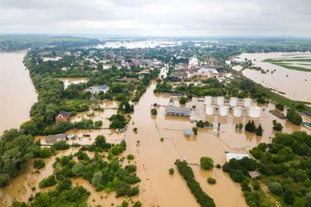 Aerial view of flooded houses with dirty water of Dnister river in Halych town, western Ukraine. Reklamní fotografie