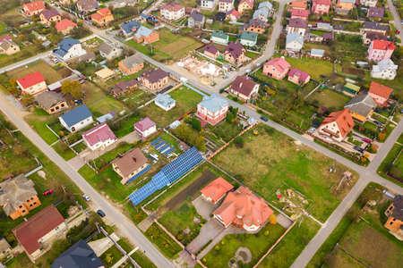 Aerial view of home roofs in residential rural neighborhood area.