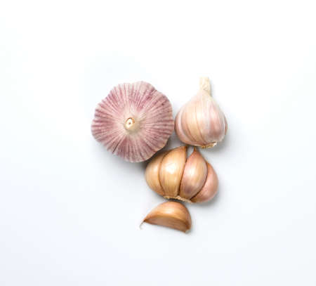 Fresh clean garlic heads and cloves isolated on white backgound.