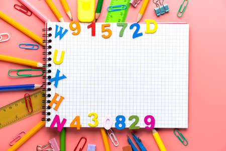 Many different school supplies on white copy space background. Back to school concept.