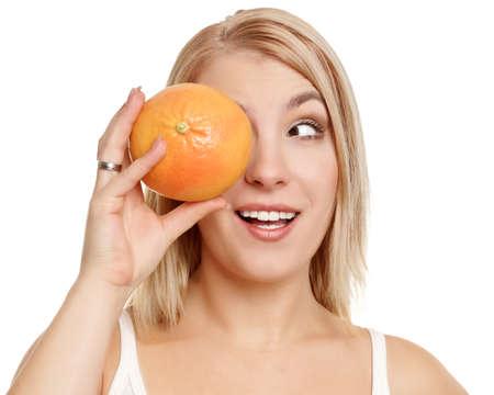 Beautiful girl with grapefruit photo