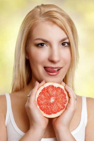 woman portrait with half of grapefruit photo