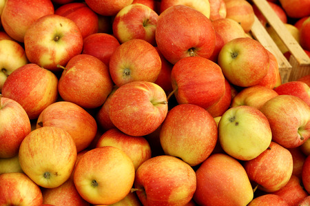 Group of red apples forming a background