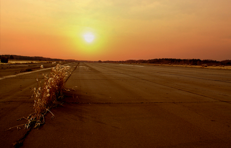 airport runway under the sun