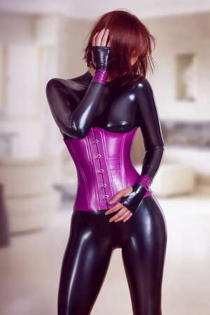 roleplaying: Young beautiful slim woman in black latex catsuit