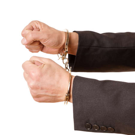 repress: hands of a man with handcuffs on a white background Stock Photo