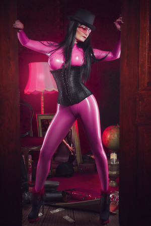 fetishism: sexy woman in pink latex Stock Photo