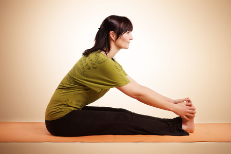 Young woman practicing yoga pose photo