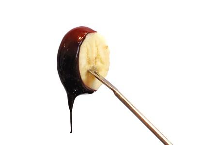 shish: Fresh banana with dark chocolate sauce dripping from it  Stock Photo