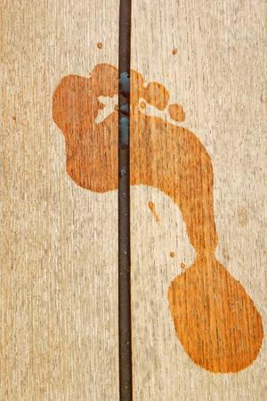footprint on wood plank                           photo