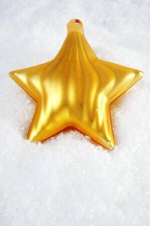 Golden Star in snow Stock Photo - 10040199