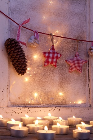 Old window with tealights Stock Photo - 11274594