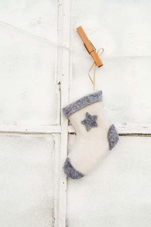 christmas sock outside old window  Stock Photo - 11274624