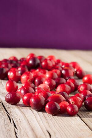 Cranberries on a rustic wood Stock Photo - 11274621