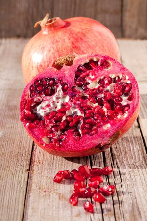 Pomegranates on wooden board photo