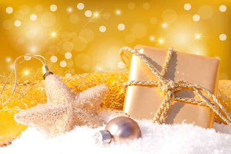 Gold gift with Christmas ball photo