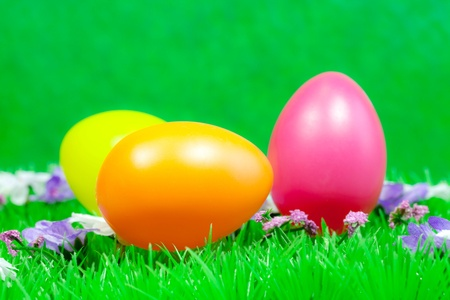 Three decorated easter eggs in the grass  photo