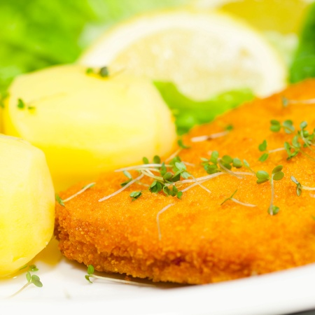 Wiener Schnitzel and potatoes photo