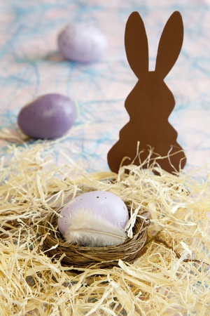 small easter basket with easter eggs  photo