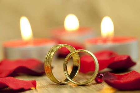Wedding rings and red roses photo