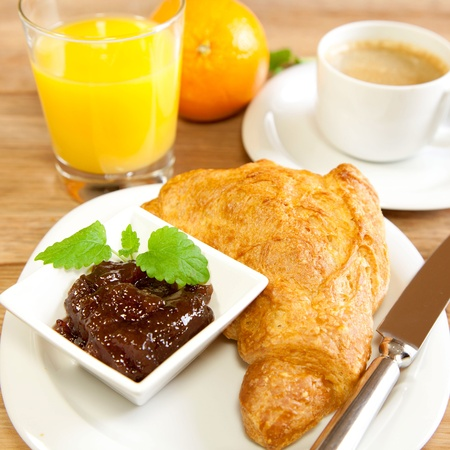 Continental breakfast with croissants and orange juice photo