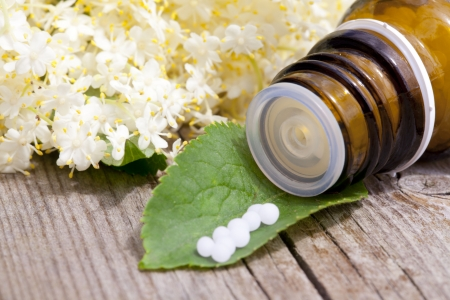 alternative medicine with herbal and homeopathic pills photo