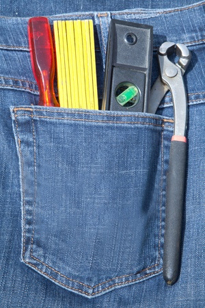 Tools in pocket jeans photo