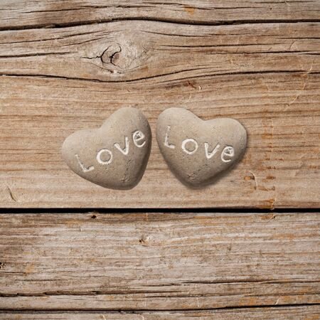 Two stone hearts on rustic wood Stock Photo - 15235900