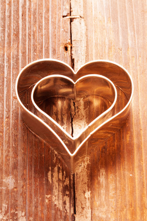 Cookies cutter heart on wood Stock Photo - 23482232