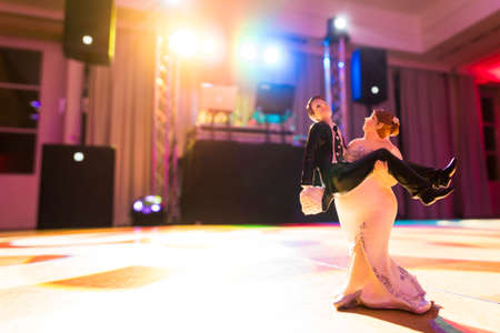 Wedding couple dancing on the dance floor during the wedding celebration Stock Photo