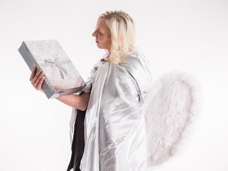 good heavens: happy teenage angel girl with christmas gift
