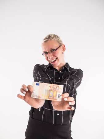 business woman puts 50 Euro in her pocket Stok Fotoğraf