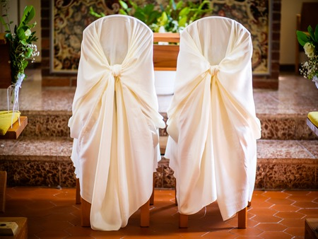 the waiting chairs in front of the altar are waiting for the bride and groom
