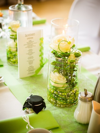 the green table decoration on the wedding table Stock Photo