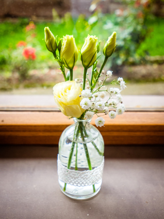 Vase with bouquet of beautiful flowers in room, closeup