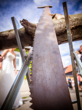 the saw on the sawhorse at the wedding, ritual at the wedding