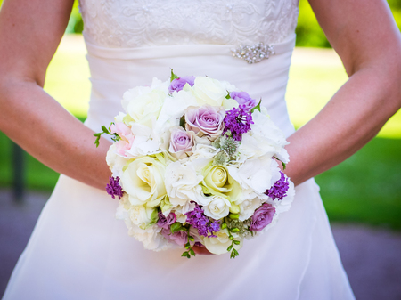 the bridal bouquet in the hands of the bride with pink and white roses Stok Fotoğraf