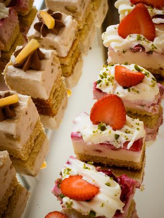Wedding cakes set on glass shelf minicake Archivio Fotografico