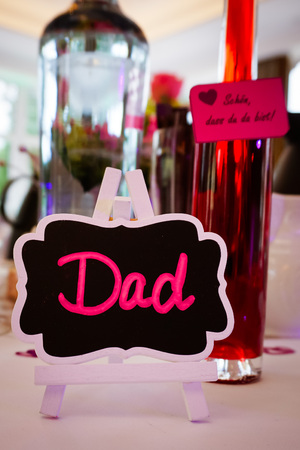 The place card for the name DAD, dad his place Stock Photo