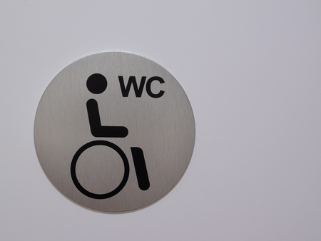 The disability sign, sign with space to write, a photographed sign behind wheelchair accessible Stock Photo