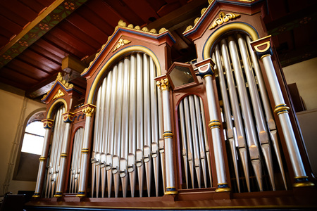 The organ in the church made of wood old and restored Stock Photo