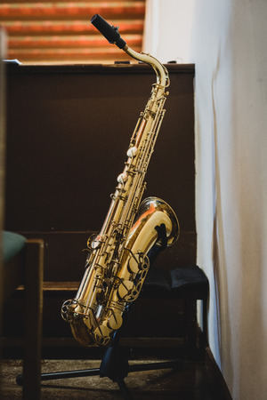 The saxophone in the church, the choir are accompanied Stock Photo