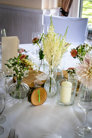 Handmade wedding decoration, flowers, wood, flowers in vintage and natural look