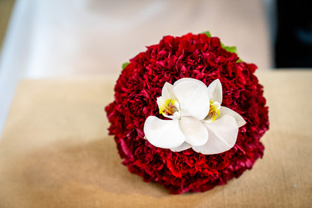 Stunning bridal bouquet. Wedding ceremony. Mix of peonies, orchids and roses. Modern bridal accessories. Wedding flowers
