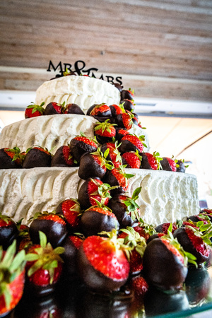 The wedding cake with strawberries and chocolate, three-tier, 3, cream and fondant